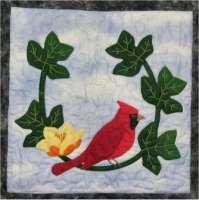 Cardinal and Tulip Tree Flower