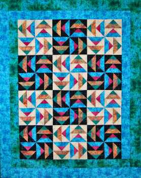 Rainbow Flying Geese Quilt